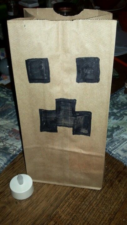 Creeper luminary: brown paper bag, flameless candle. Kids LOVED coming up the walk lit by these. It's Christmastime & our house looks Halloween, but worth it. Pic only, no link.