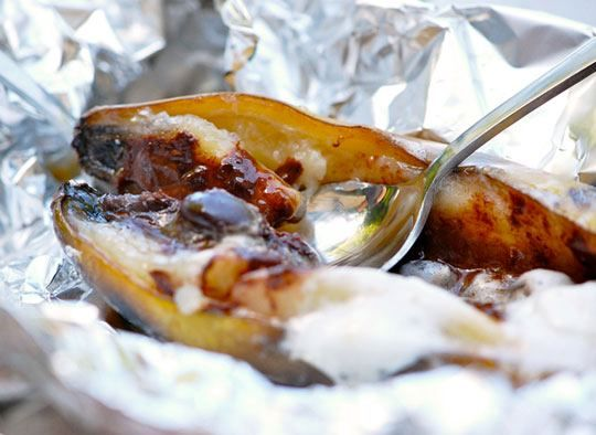 "banana boat smores? ""Roll up a banana in foil, with marshmallows and chocolate stuffed inside. Grill, eat, repeat.""   SOURCE: http://www.thekitchn.com/campfire-treat-banana-boat-smores-177061"