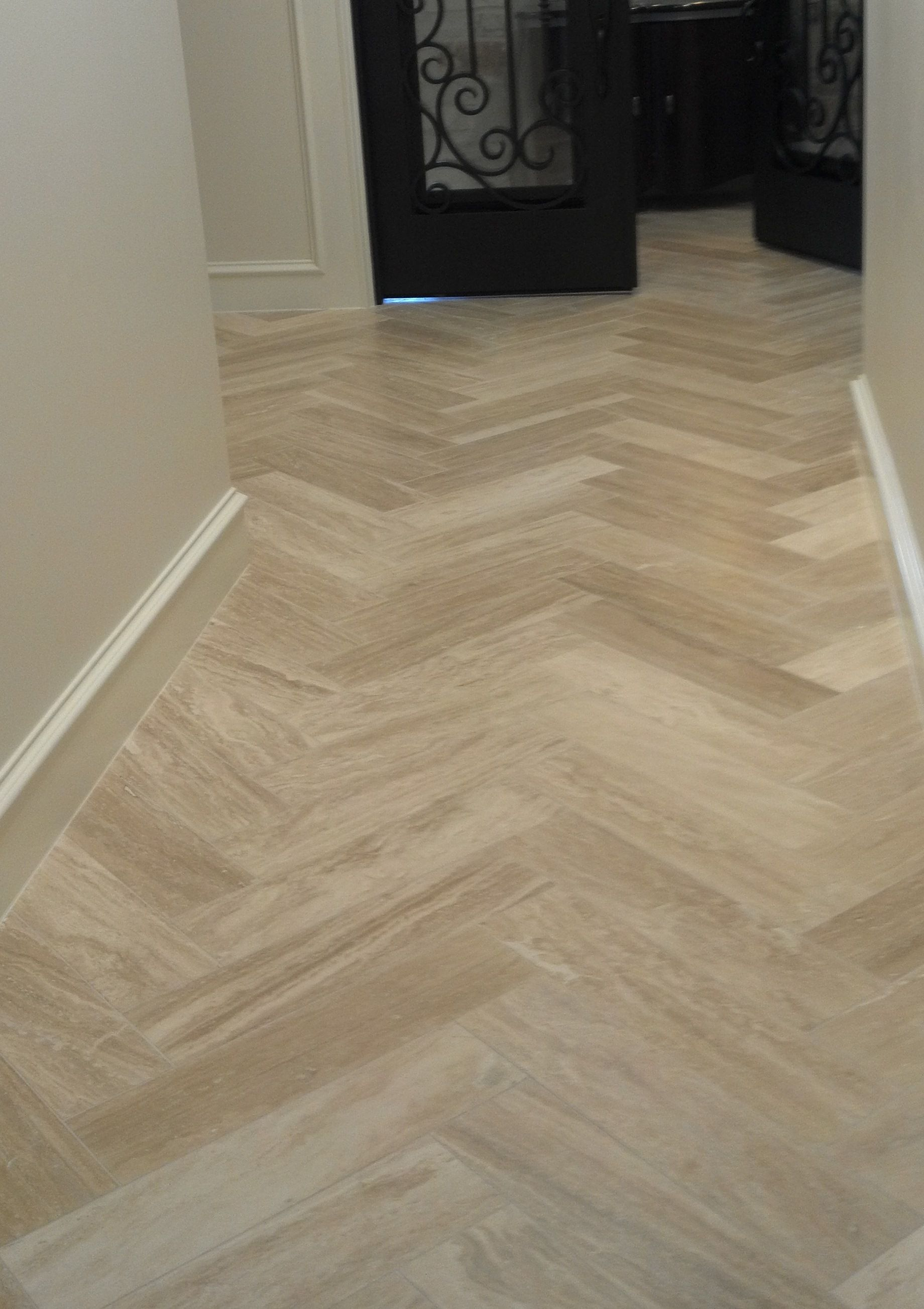 Light tile with a seamless transition to dark wood floor perfect travertine tile planks emser tile dailygadgetfo Images