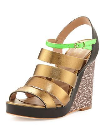 At first glance, we admit these look extreme. But think of that color against your tanned skin! And the sky-high wedge only does good things for a derrière. $52 (reg$180) #bargain