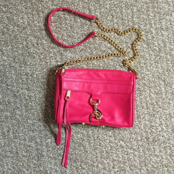 Rebecca Minkoff Mini MAC bag in Fuchsia Rebecca Minkoff Mini MAC bag in Fuchsia. Used a handful of times, but in excellent condition. No visible scratches or marks. Comes with replacement tassels and dust bag. Rebecca Minkoff Bags