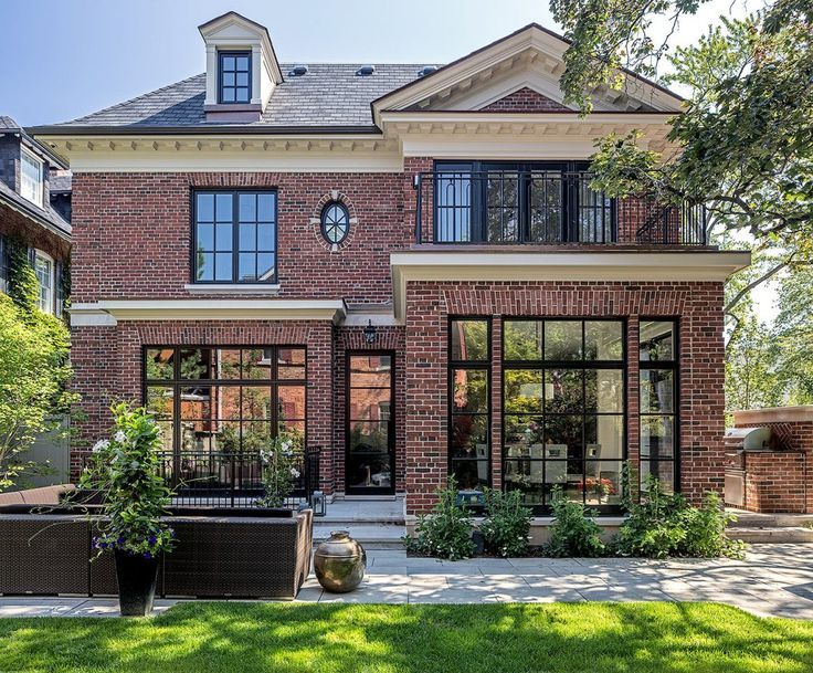 Classic transitional modern brick home with outdoor entertaining space | Check out www.sketchpadhouseplans.com for great house plans! #exteriordecor