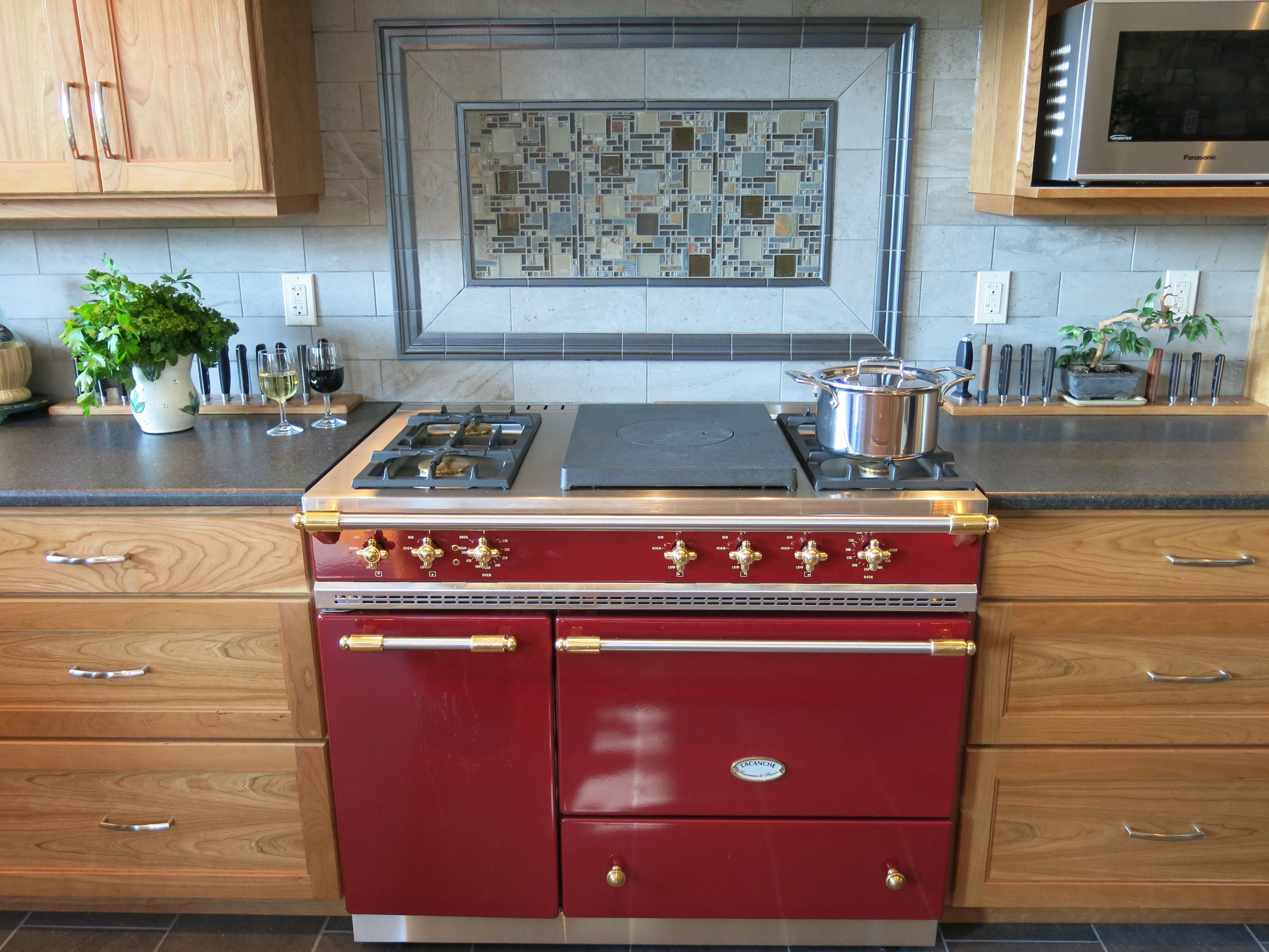 A Glass Of Wine A Stunning Backsplash And A Burgundy Red Lacanche Range In The Heart Of The Rocky Mountains What Else Can You Cooking Range Kitchen Burgundy