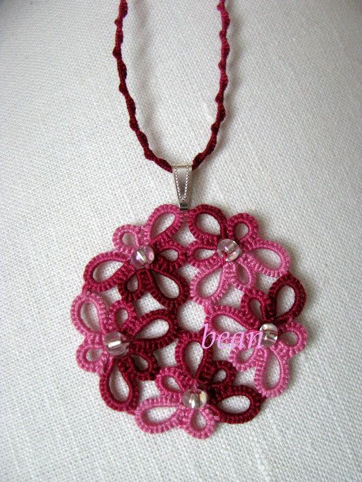 Pretty tatted lace, beaded pendant on a spiral tatted cord.