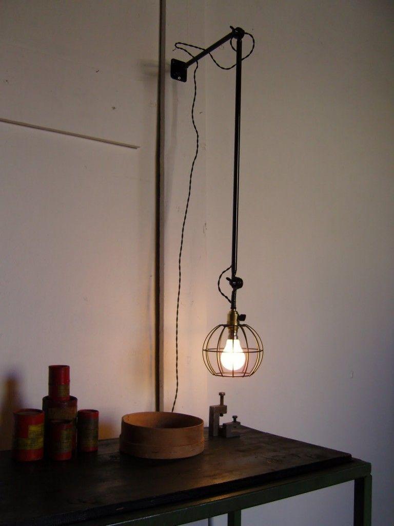 cage potence wall light