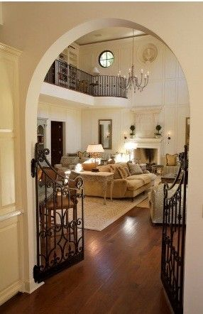 old gates can be used inside the home for dogs or babies.  Great idea, and it looks better. and look at the open 2nd floor above the main family room. good ideas