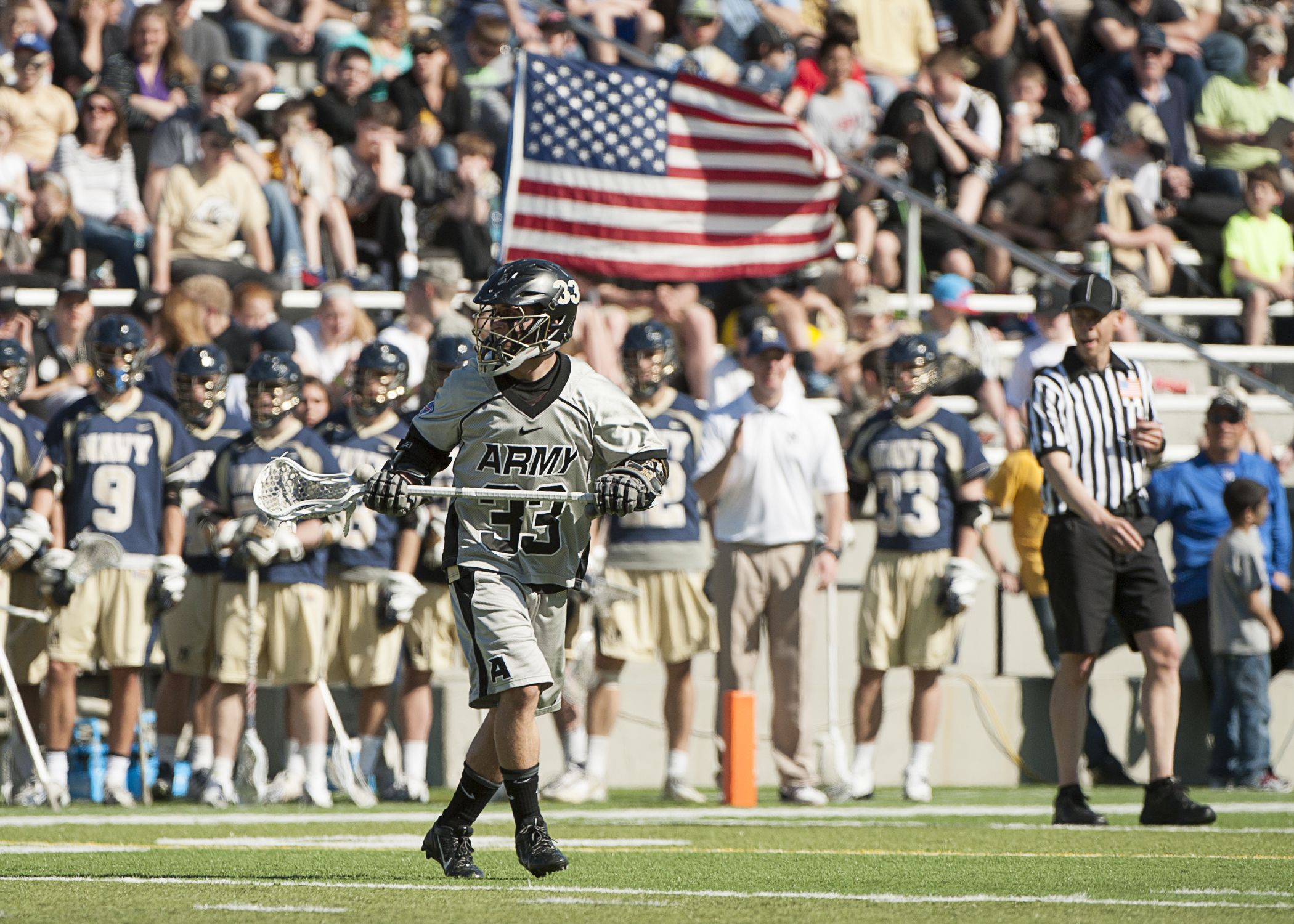 Army's Will Mazzone with the U.S. flag in the background of the 93rd Army-Navy lacrosse game.