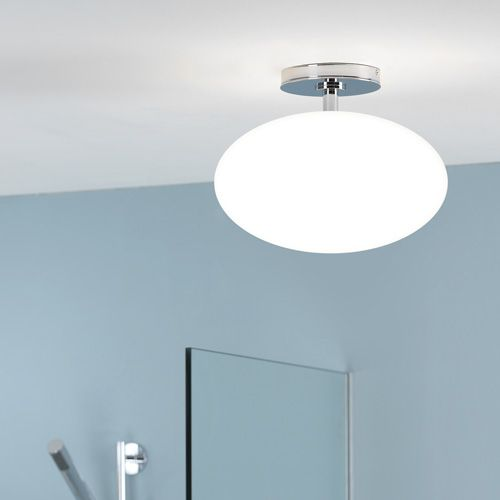 A Semi Flush Bathroom Ceiling Light With An Oval Shaped White Gl Shade Simple Yet Stylish