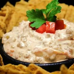 Always a crowd pleaser and so easy to make. This recipe can be as hot or as mild as you like, depending on which kind of tomatoes you buy. I got this recipe from a friend. Serve with tortilla chips.
