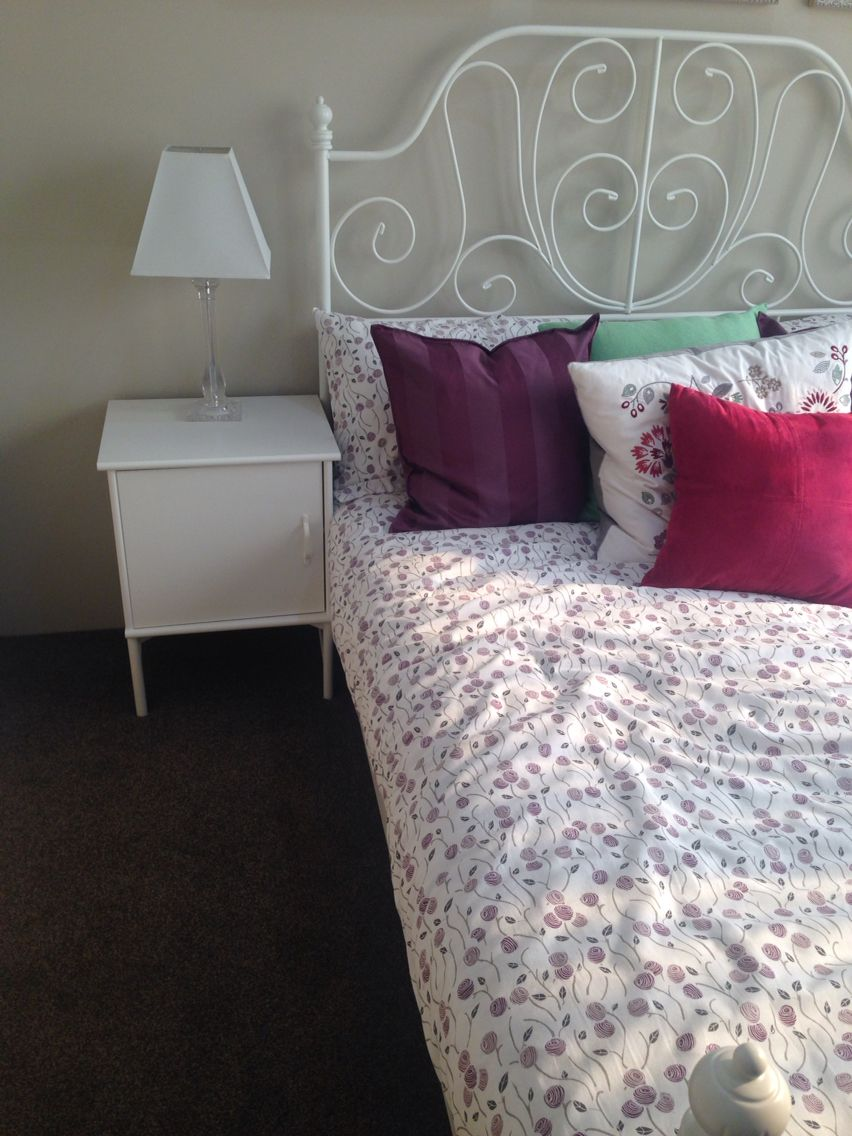 I like the simple bedside table