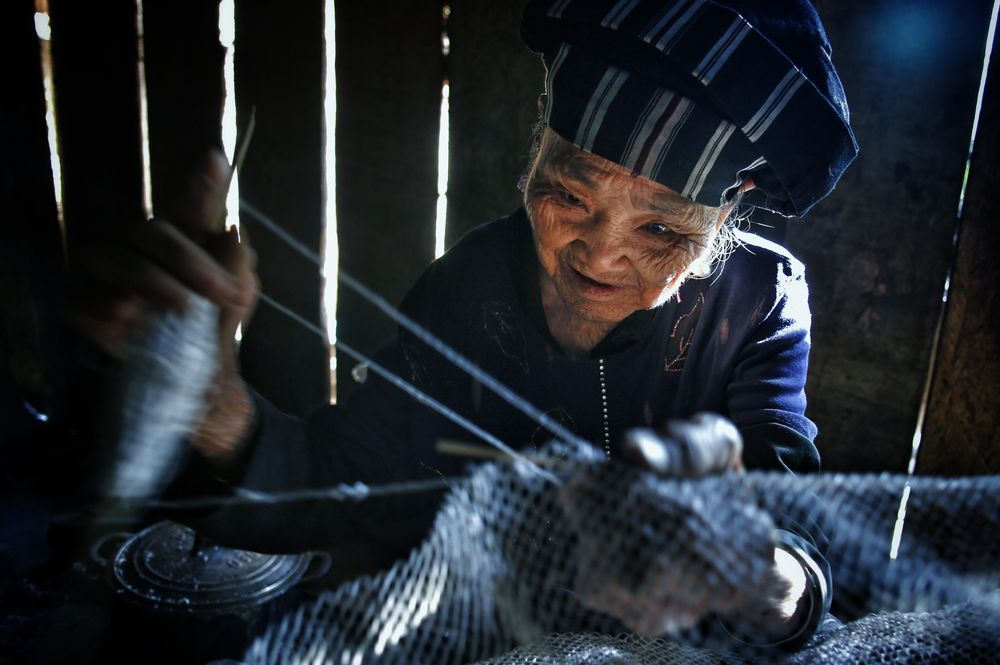 Fixing net Photo by Viet Thanh Nguyen -- National Geographic Your Shot