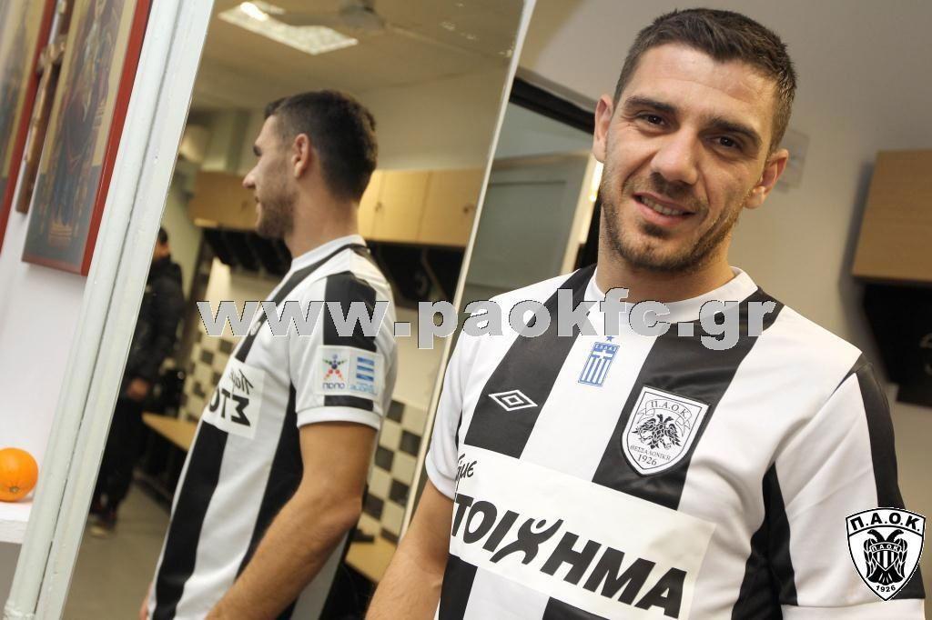 Kostas Katsouranis with black and white stripes in Toumpas stadium dressing room