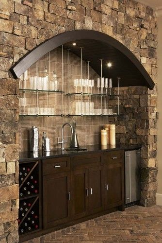 Wet Bar - I really like the glass shelves up top & the arch. I ...