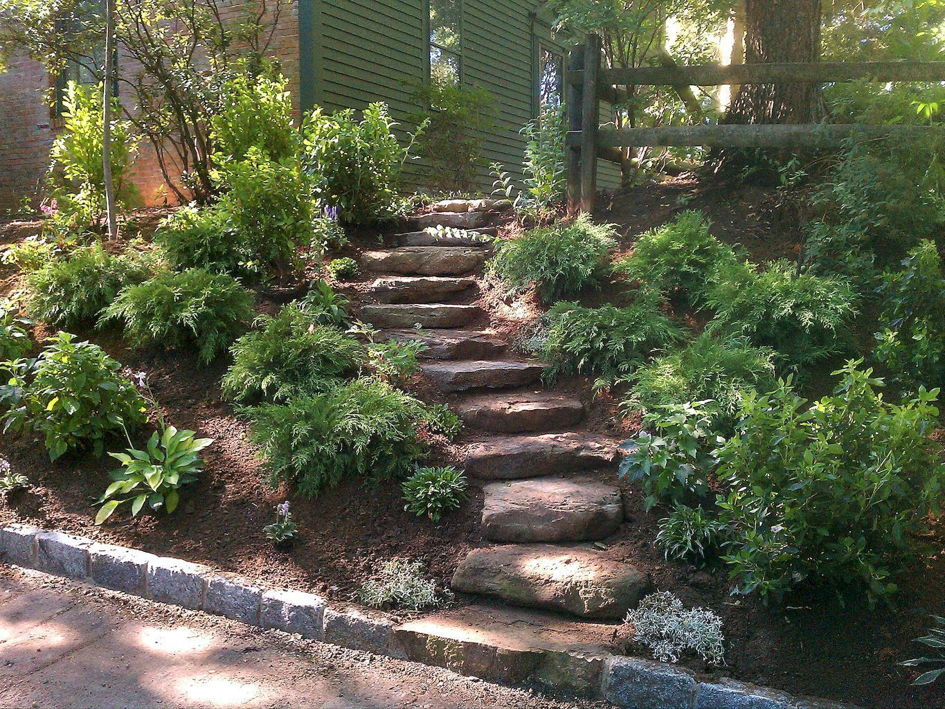Try These Backyard Landscaping Ideas on a Budget | Sloped ... on Small Sloped Backyard Ideas On A Budget id=21372