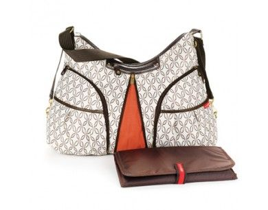 Looks like a purse, but it's a diaper bag! expandable and stroller friendly