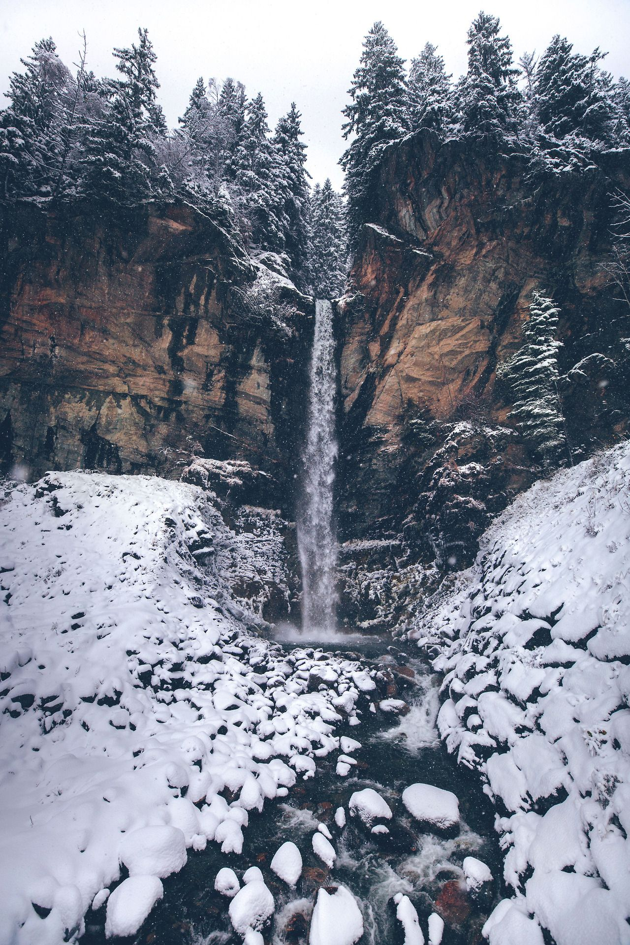 Rushing in the stillness of falling snow Austria by Denny Bitte - #artists #Austria #bitte #creek #denny #forest #hiking #landscape #nature #on #original #photographers #photography #snow #snowfall #travel #tumblr #vertical #waterfall