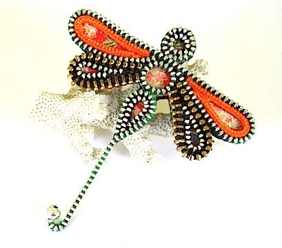 Dragonfly Brooch - Orange Zipper-  made from recycled zippers and chiyogami papers. The silver teethed zippers in this piece have green and purple fabrics while the gold teeth in the lower wings have black fabric.
