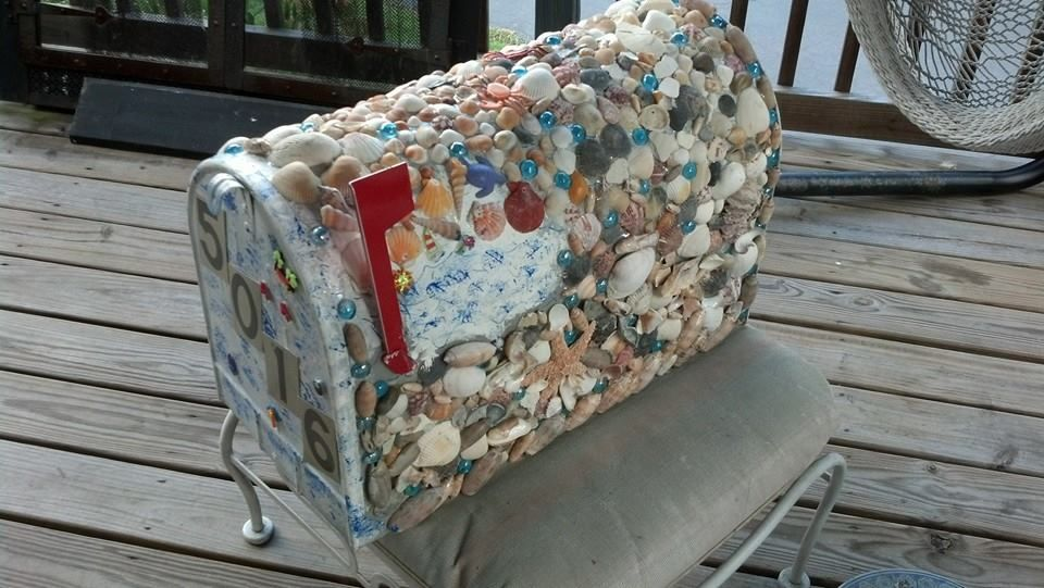 mailbox made from shells.. I used E6000 glue, shells colored rocks . shells I picked up on the florida beaches