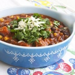 Deliciously healthy chicken chili topped with fresh cilantro!