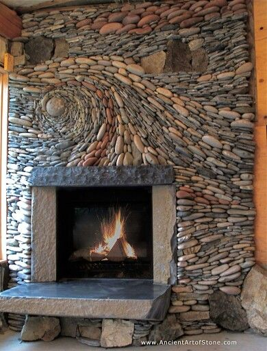 Ultimate diy rock collage fireplace.. i could totally do this with the right materials.