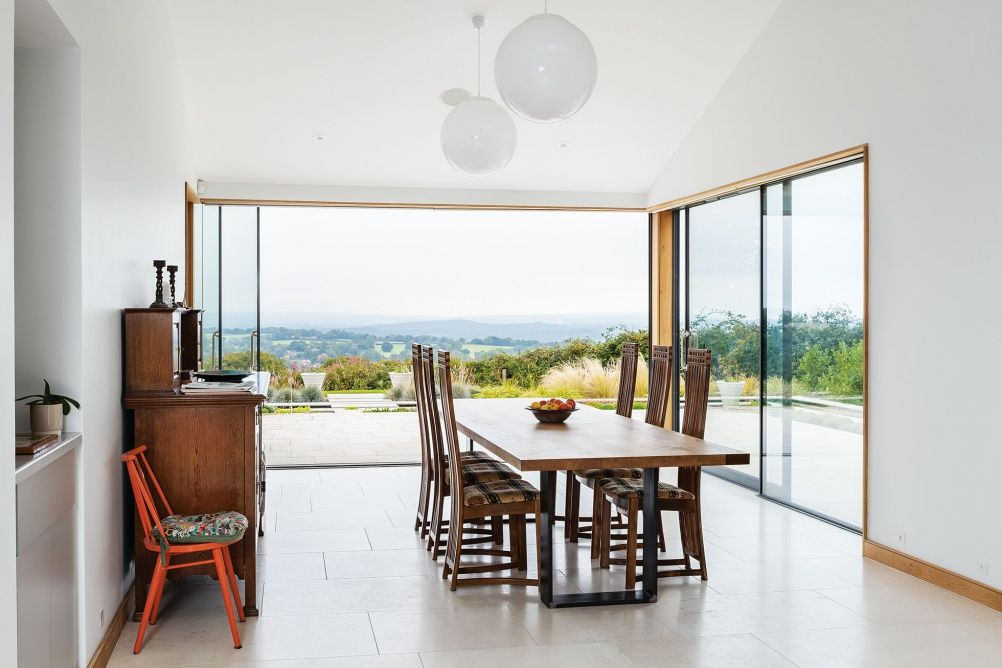 The dining space opens up onto the garden through doors from Fineline Aluminium & The dining space opens up onto the garden through doors from ... pezcame.com