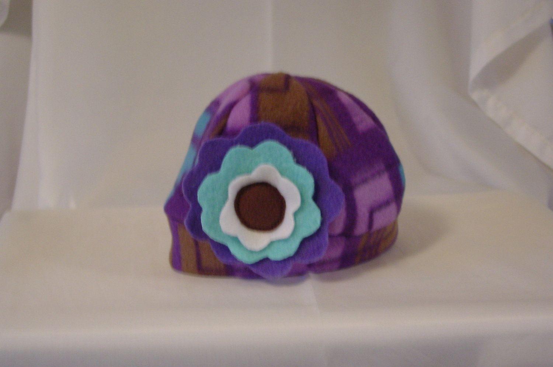 Baby hat girl purple fleece with flower. $13.00, via Etsy.