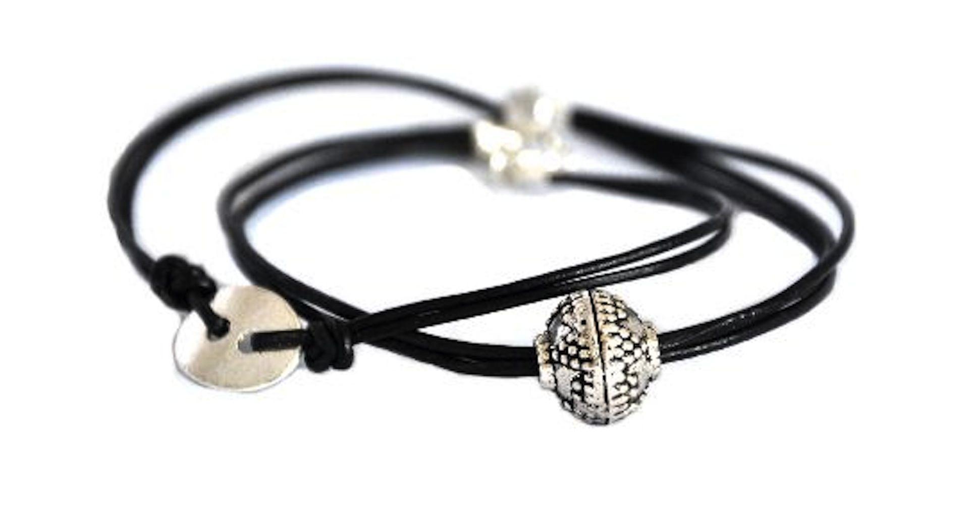 Multi strand leather bracelet silver charms