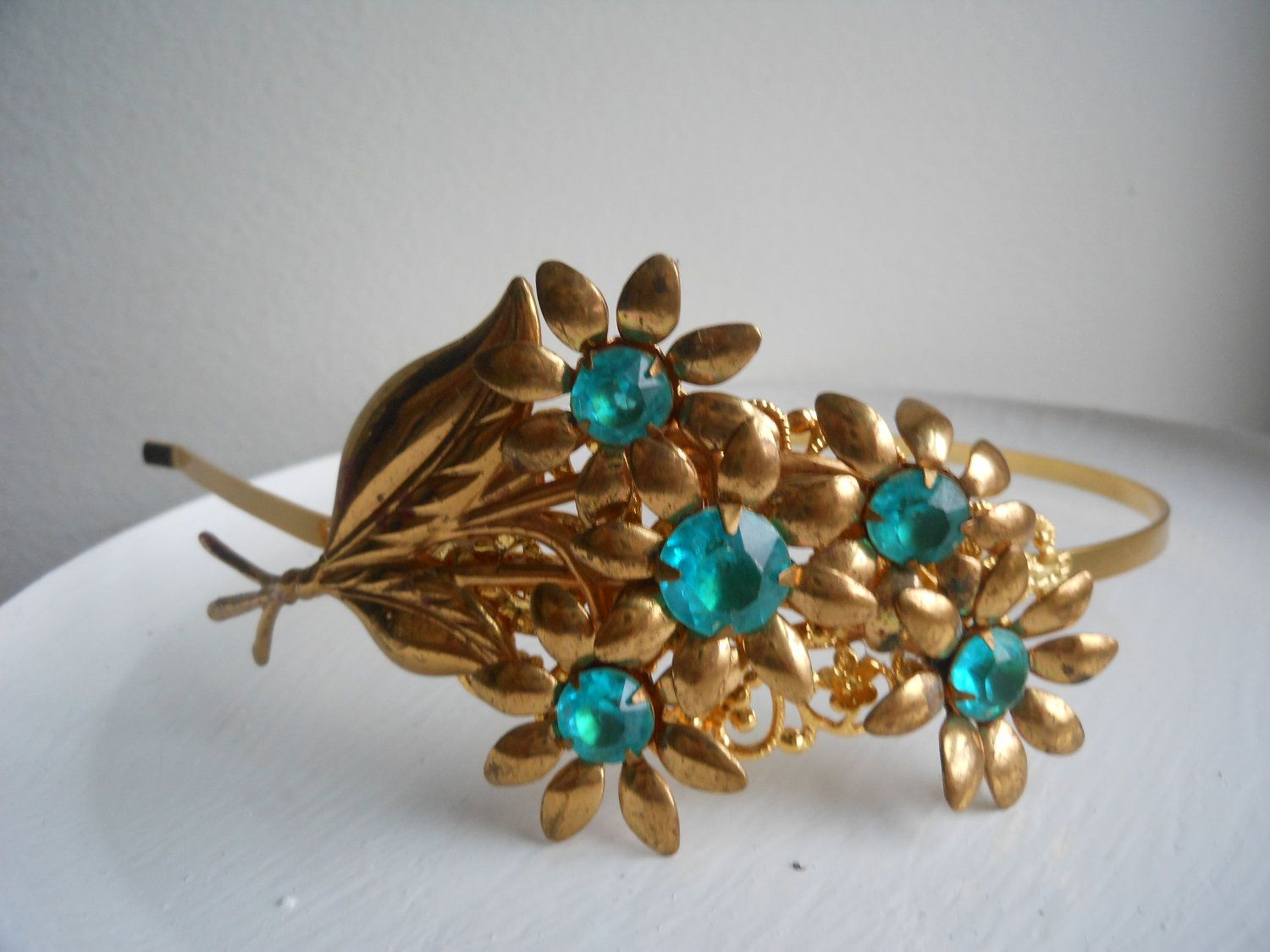 This georgeous blue rhinestone and flowers headband is wonderful.  It is made using a vintage art deco brooch and then I added it to a new gold plated filigree headband.    This would be great for that wedding, or any day.  Something blue for sure. Great for the reception after youtake your veil off...    $49.99