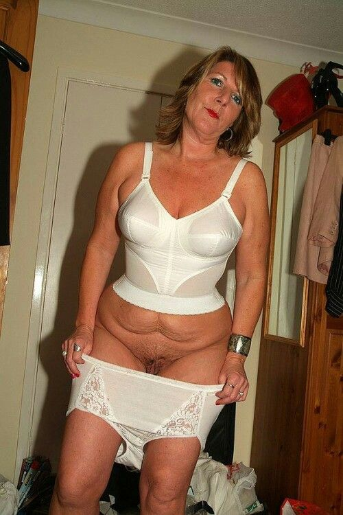 Middle aged women undressing