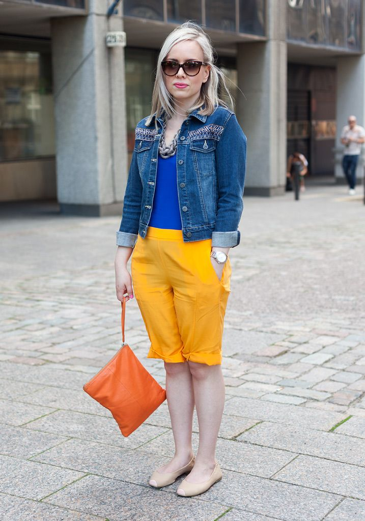 """Laura, 28  -- """"I'm wearing a second hand jacket, a top and shorts from COS, Monki shoes and a Marimekko bag.  Lately I've tried to find a more adult, simple and tranquil style like the one that Stella McCartney has."""""""