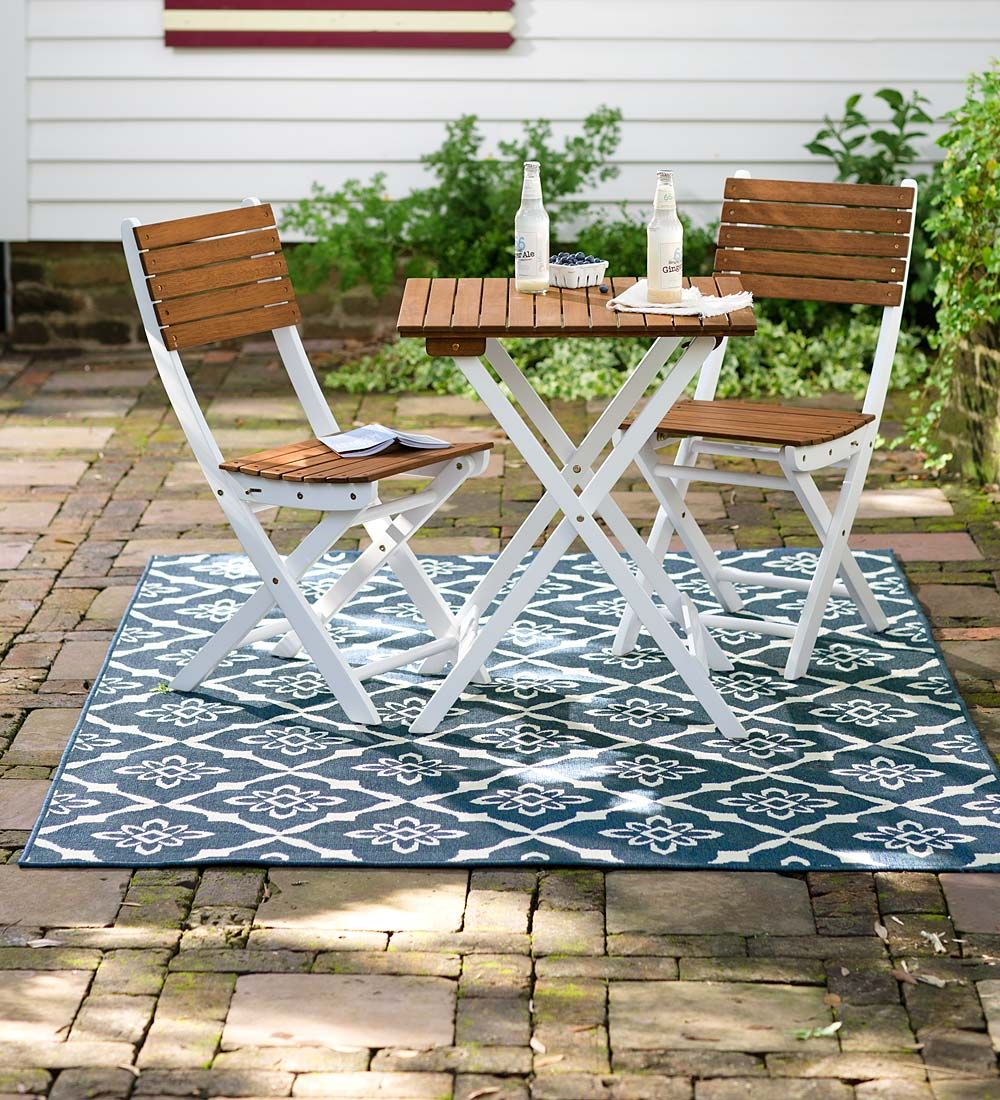 Add our easy care Indoor/Outdoor Lexington Trellis Rug for