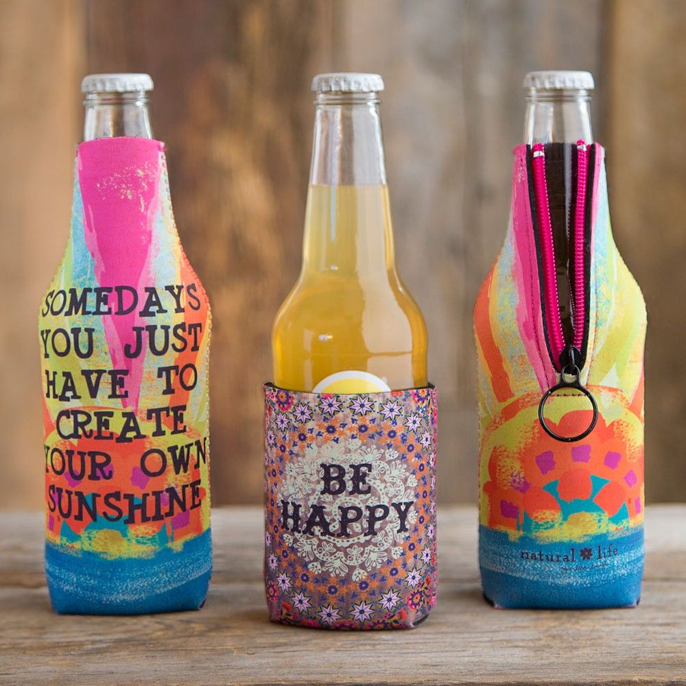 Drink Cozies - The Natural Life drink cozy is a perfect way to add a touch of fun to any occasion while keeping cans and bottles cold. Made of neoprene, with positive sentiments over lovely nature photography on the front, and floral print on the back. No more warm drinks or cold hands!