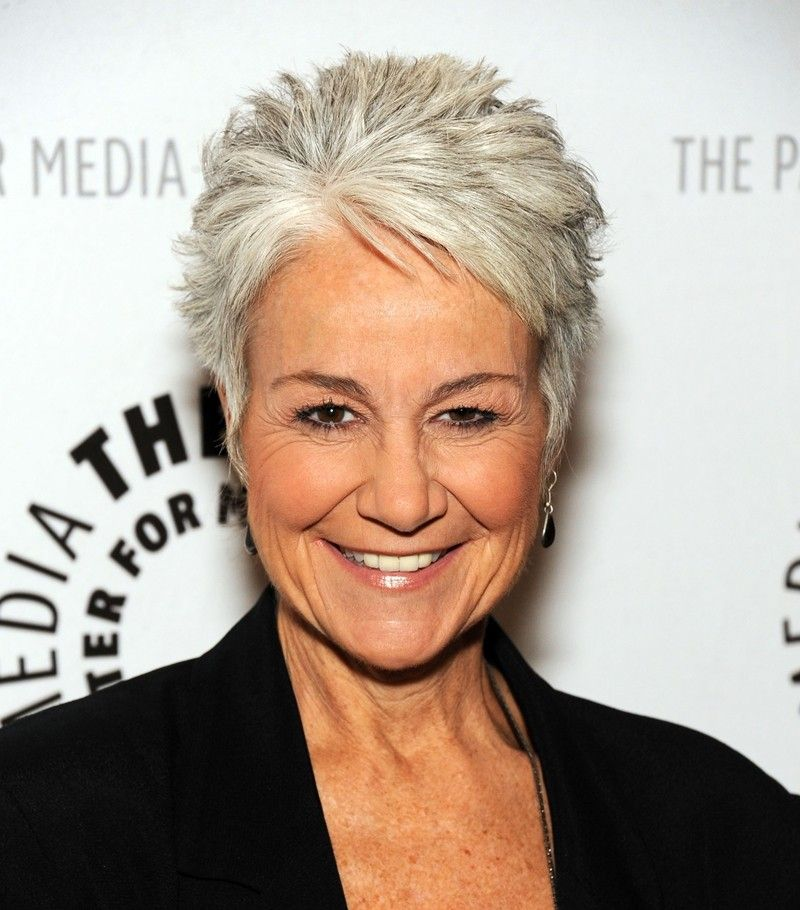 Hair pros say gray hair looks best short.  Try a pixie or short crop like Andrea Romano's for an edgier gray style.