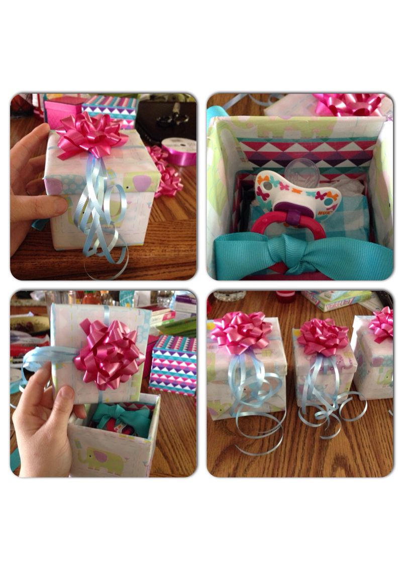 Pregnancy announcement idea:  I wanted to make the announcement special for my parents so I used small gift boxes, wrapped the bottom of the box in cute wrapping paper and then wrapped the top separately so all they had to do was pull the top off.   I added folded up tissue paper to the inside of the box, decorated the lid of the box with ribbon. Then added a binky with a ribbon on the handle. Since the gender is unknown, I did pink and blue. They loved the announcement.