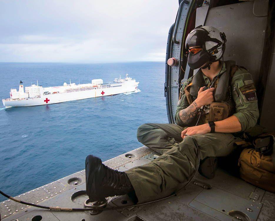 Navy petty officer 2nd class matt braaten looks out from
