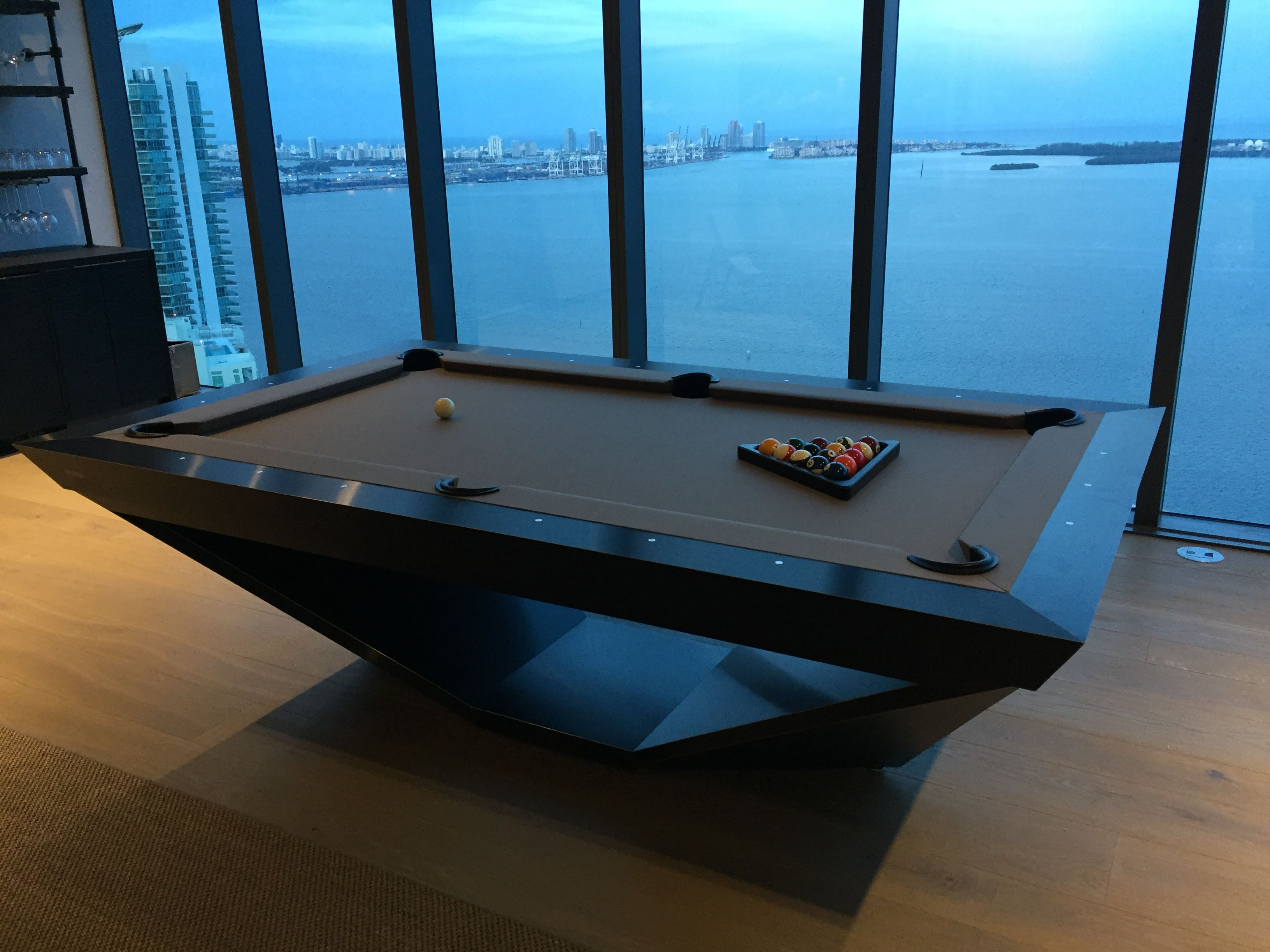 Drawing Influence From The Stealth Bomber Aircraft 11 Ravens Brings A Model That Is Precision Engineered And Unc Modern Pools Modern Pool Table Diy Pool Table