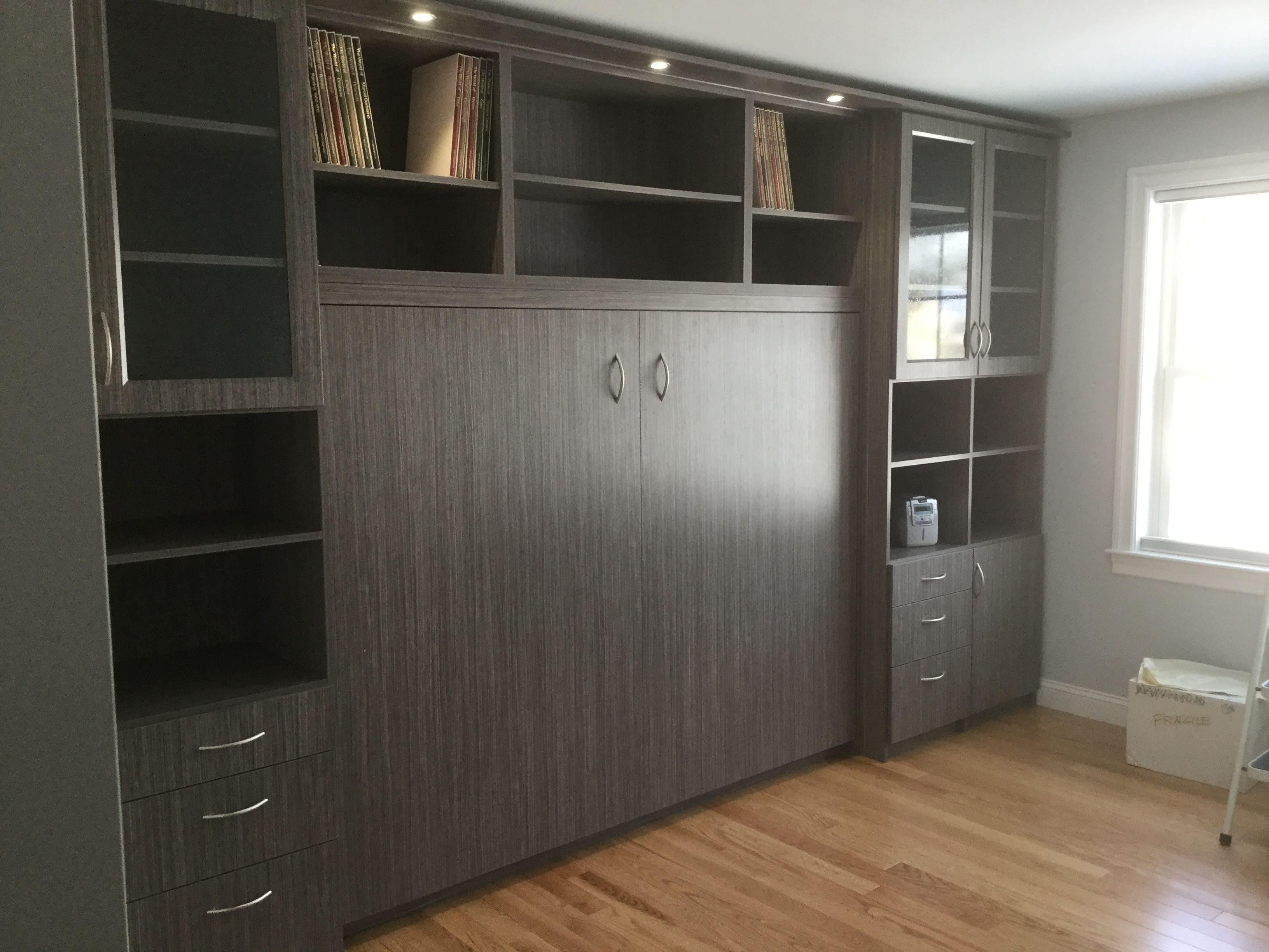 This beautiful murphy bed in the home office hides away beautifully