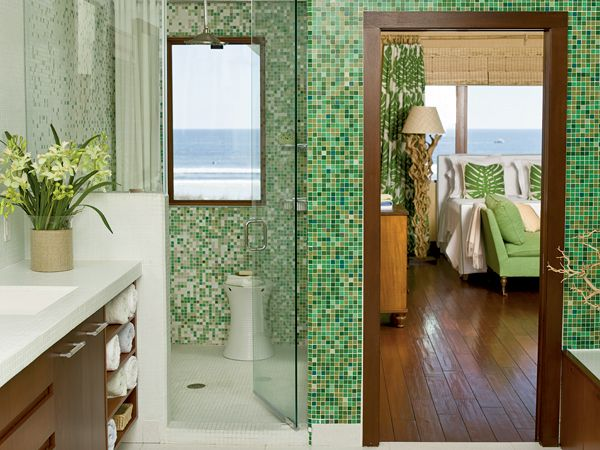 The seaweed green mosaic tile in the master bathroom inspired the