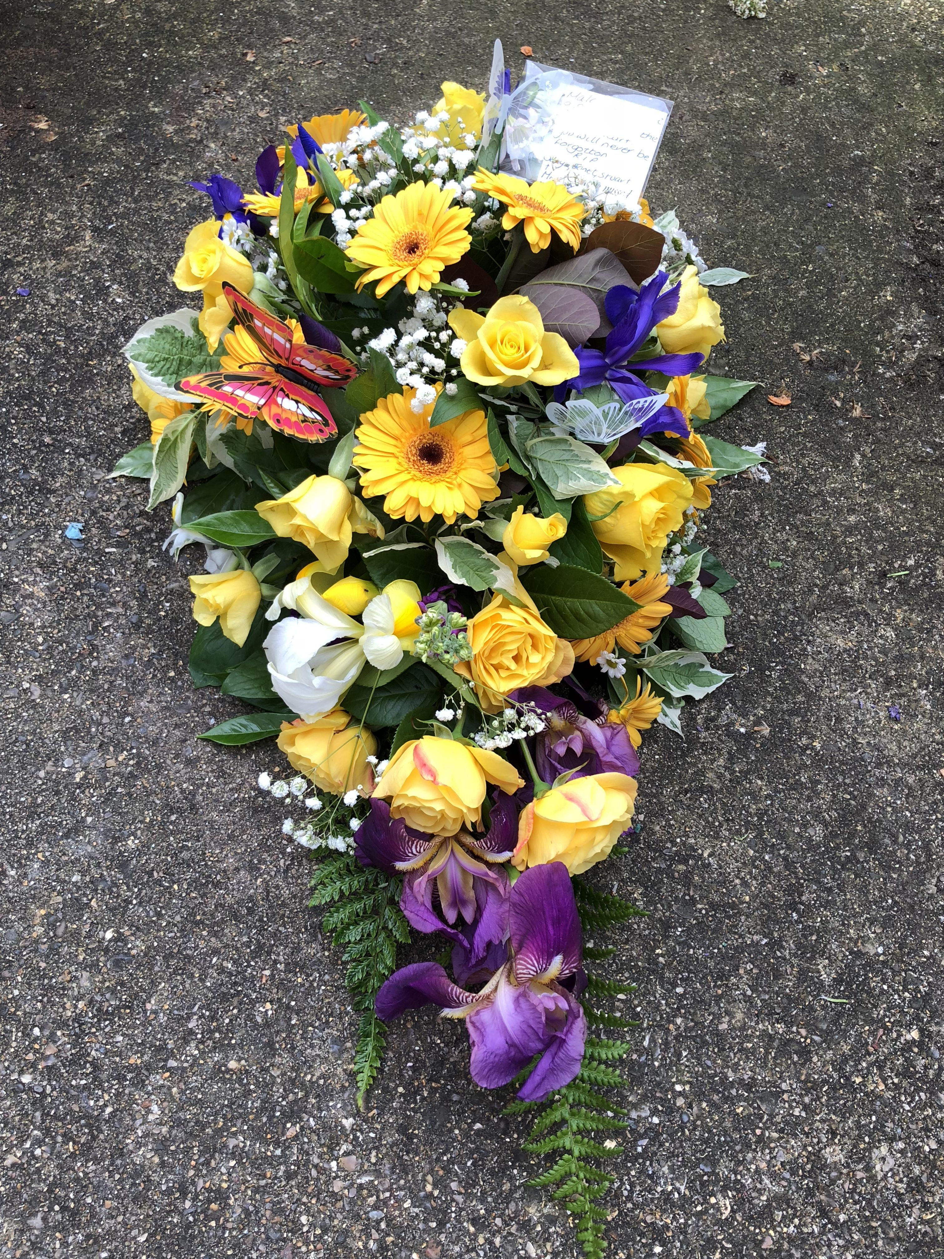 A Yellow Purple Single Ended Spray For A Close Friends Funeral