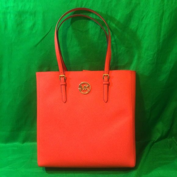 """Michael Kors Saffiano Jet Set Tote Mandarin Orange Michael Kors Saffiano Leather Jet Set Travel Large NS Tote Mandarin Orange Leather Vintage yellow saffiano leather with golden tone hardware Lined interior with zippered pocket and 4 open slip pockets Magnetic Snap closure; flattened bottom panel; rear open slip pocket Dual leather straps with a drop of about 9"""" Measures 13.5"""" (L) x 14"""" (H) x 3.5"""" (W) Michael Kors Bags Totes"""