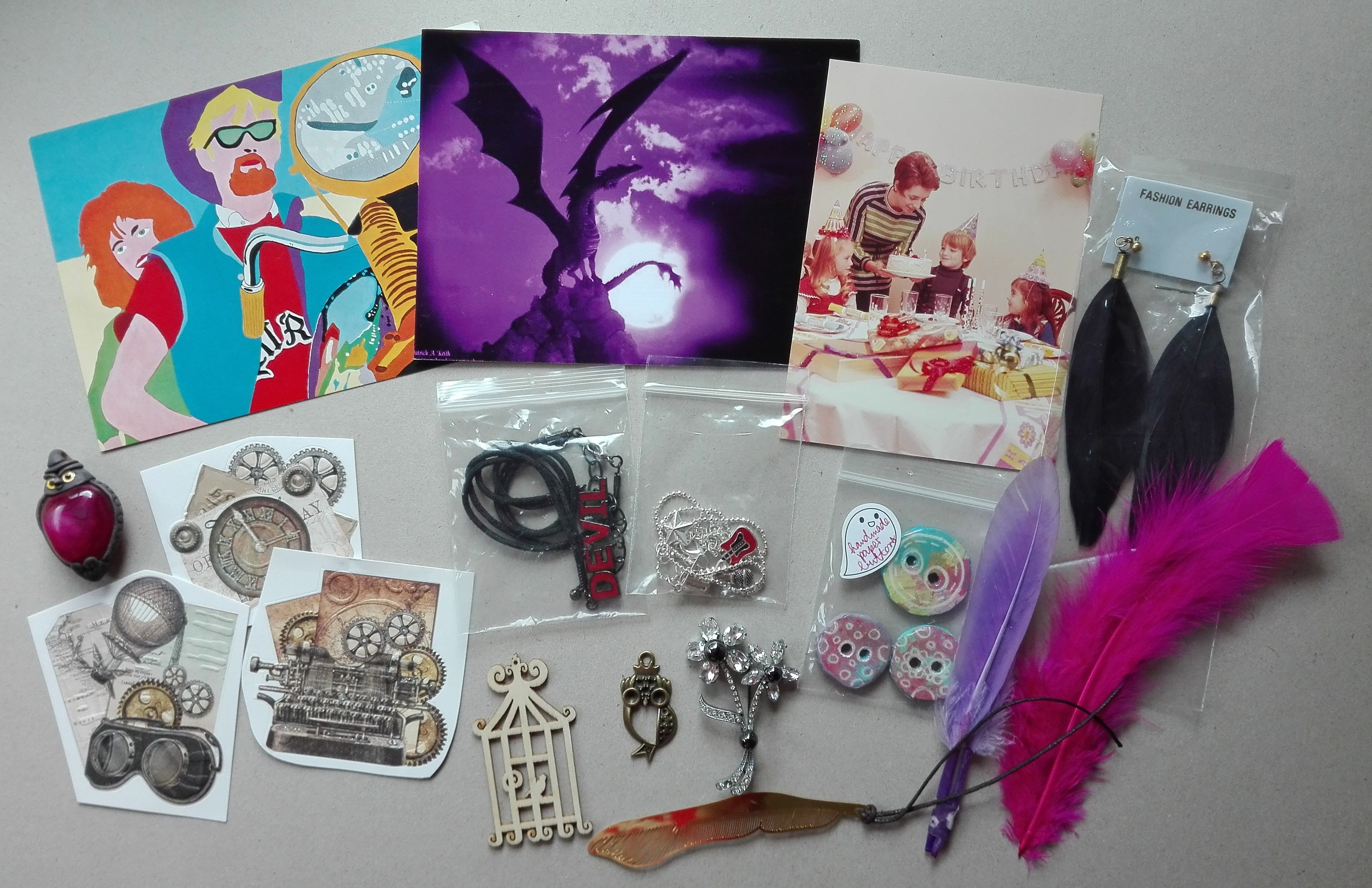 Sent to Canada: postcards, stickers, jewelry and feathers (QUICK flat destash swap #117)