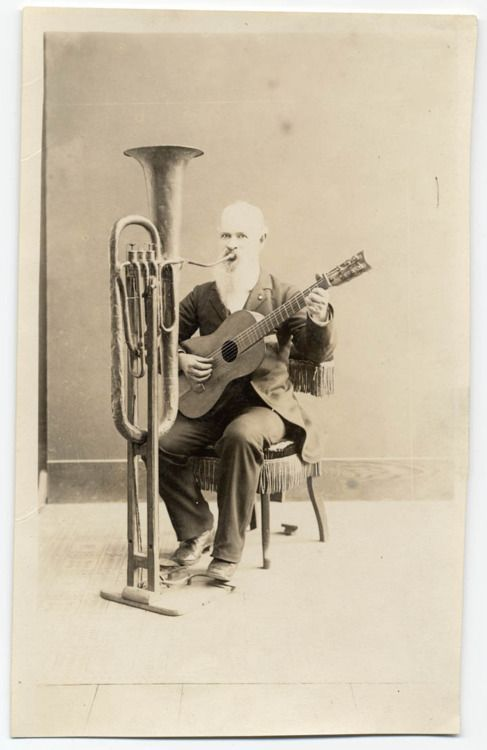 C.W.J. Johnson with his one-man band invention. (1890)