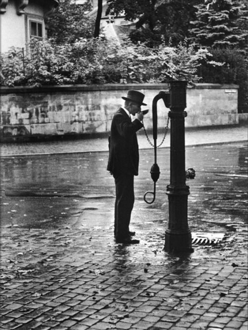 Man Drinking from Public Water Pump Fountain on Street, Frankfort-On-The-Main, Germany | Alfred Eisenstaedt