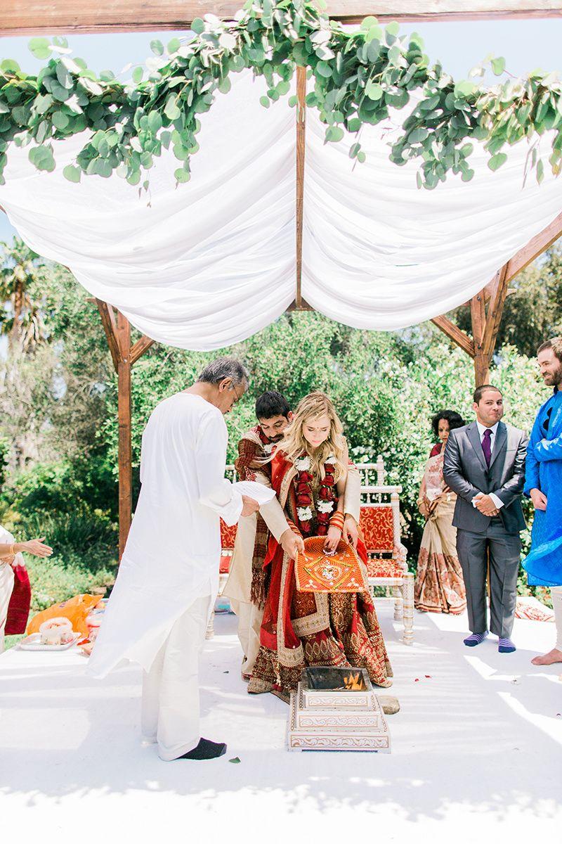 Indian Wedding Under Simple Mandap With Green Garland In Garden
