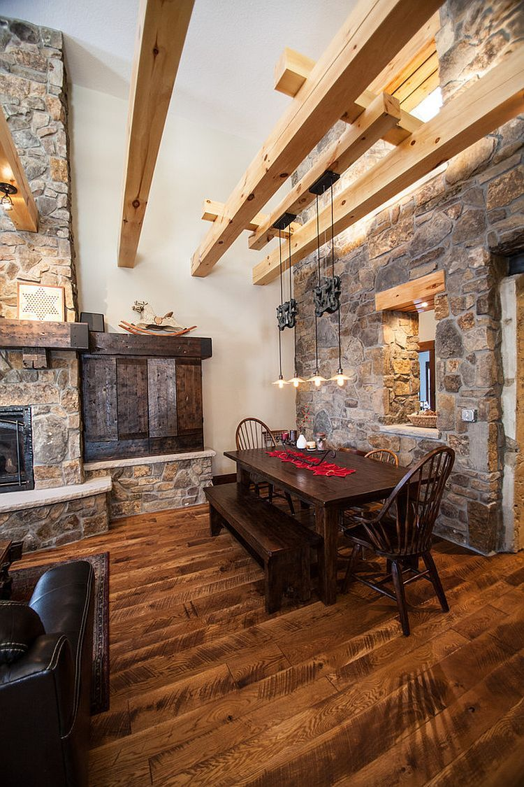 Farmhouse-style-dining-room-with-wooden-beams-stone-walls-and-ingenious-lighting