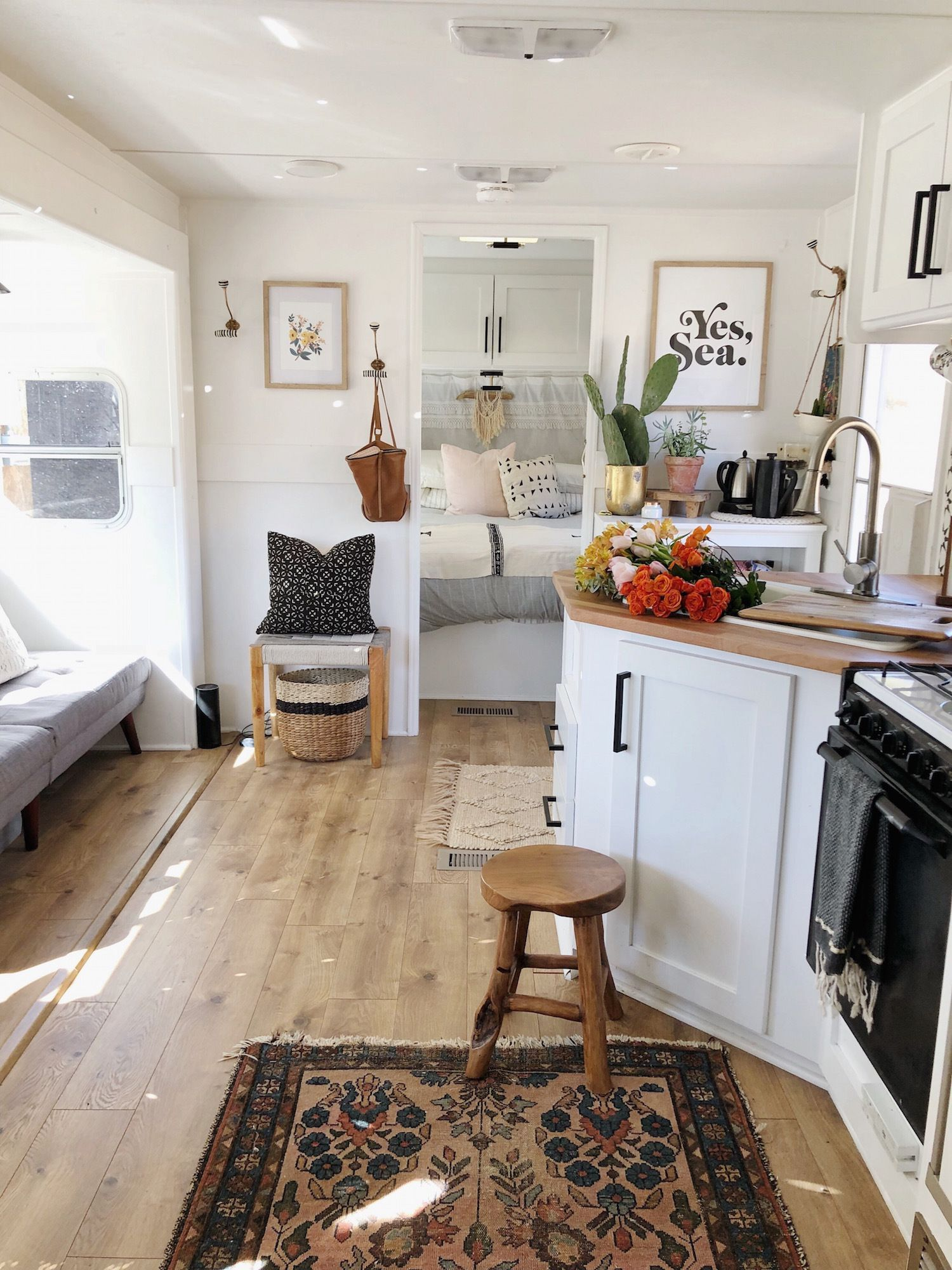 The couple share the master bedroom with a sliding door. #rv #camper ...