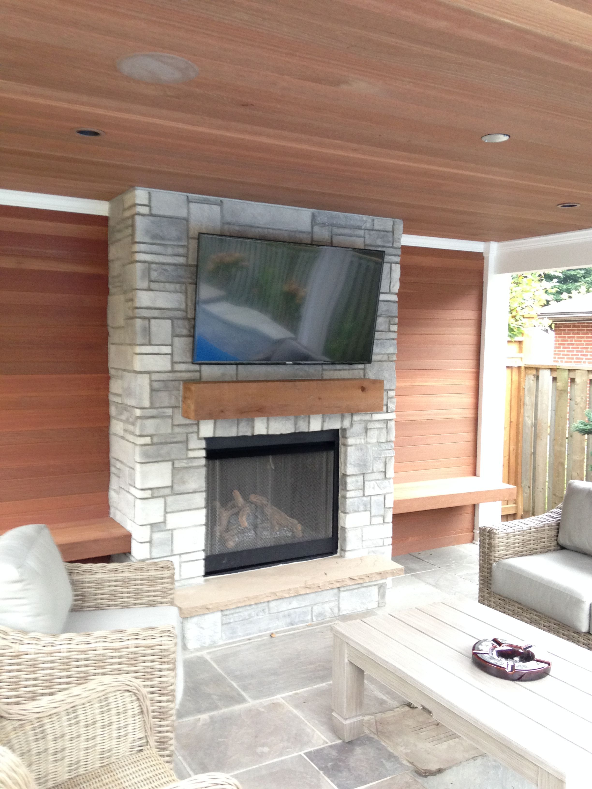 poolside cabana pool house with fireplace and feature wall using