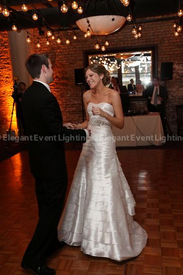 The soft, amber glow of Café Globe Lighting adds a romantic effect to your Spring Wedding!