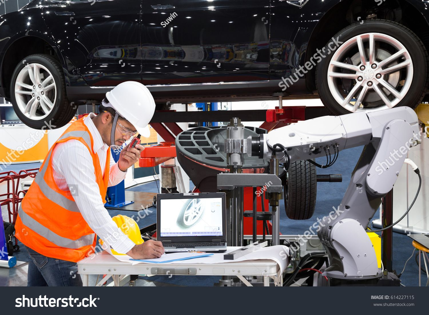 Automotive Engineer With Assistance Robotic Inspec Modern Car