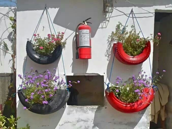 Swinging tires recycled tires flower pots planters ideas for Hanging flower pots ideas